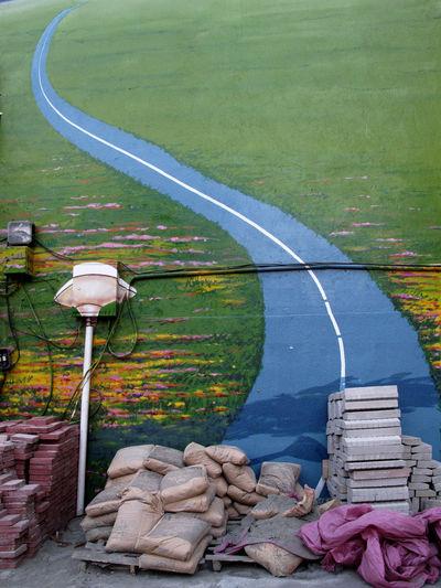 Empty Narrow Road Along Countryside Landscape