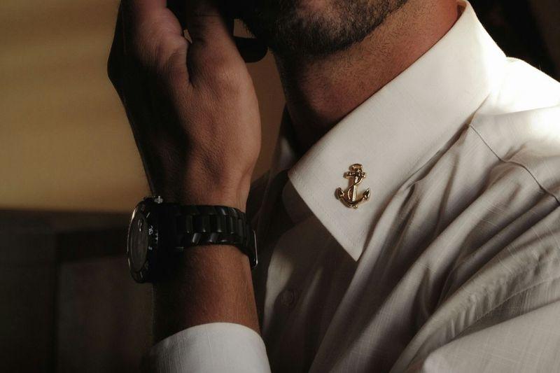 Close-up of man wearing shirt and wristwatch