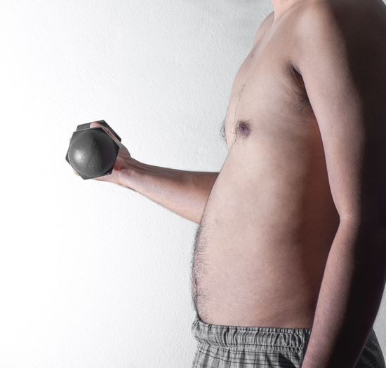 fat man with dumbbell BIG Fat Dumbbell One Person Indoors  Women Studio Shot Human Body Part Adult White Background Lifestyles Human Arm Human Limb Holding Body Part Side View Limb Arms Raised