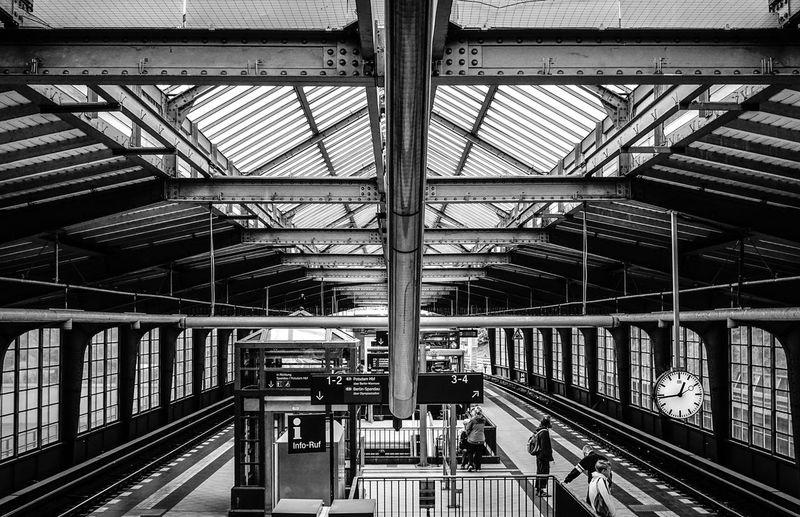 Commuters waiting on platform at berlin westkreuz station
