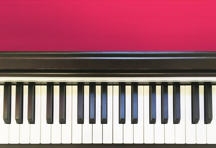 Red No People Pattern Close-up Piano Musical Equipment Music Backgrounds Musical Instrument Full Frame Arts Culture And Entertainment Piano Key Indoors  Wall - Building Feature In A Row Day Architecture White Color Black Color High Angle View