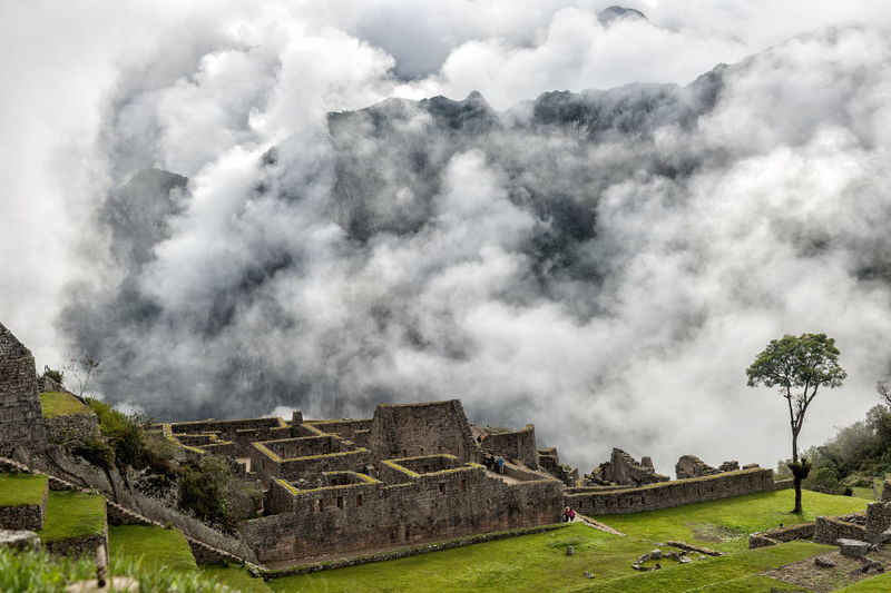 Panoramic view of castle against cloudy sky