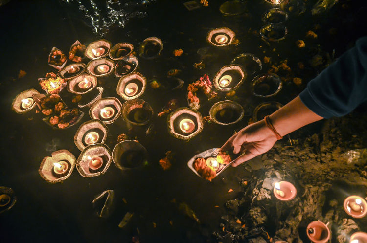 deep daan Diya - Oil Lamp Faith Flame Ganga Heat - Temperature Human Body Part Human Hand Lamps Night Nightphotography Nikon Oil Lamp One Person Stories From The City