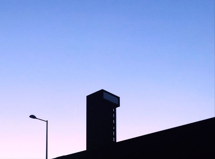 Near the Copper Box arena in the Olympic Park, London. Taken on White Post Lane at sunset. Sky Low Angle View Architecture Built Structure Clear Sky Silhouette Blue The Architect - 2018 EyeEm Awards