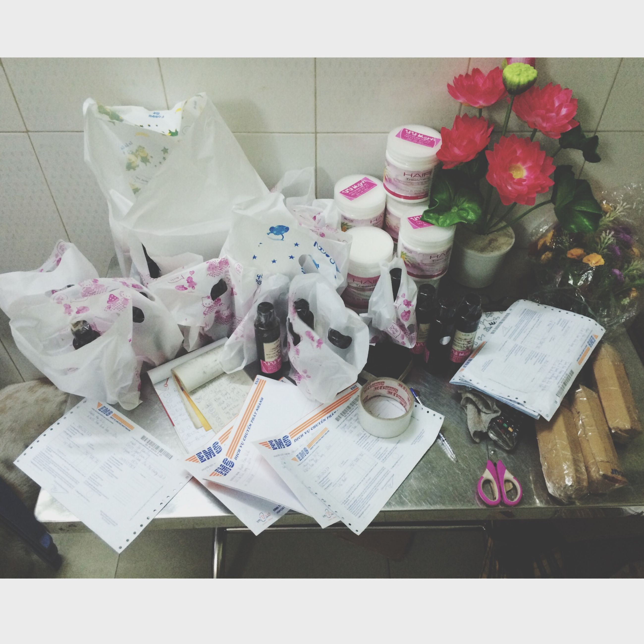 indoors, table, still life, high angle view, transfer print, auto post production filter, flower, close-up, variation, paper, freshness, no people, large group of objects, arrangement, book, directly above, group of objects, day, white color, food and drink