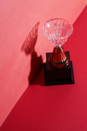 High angle view of electric lamp on table against wall