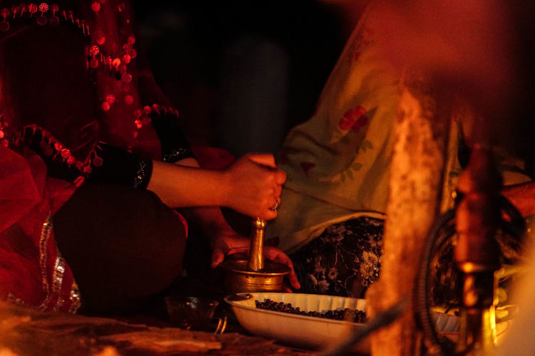 Iran Travel Destinations Travel Photography Nomadic Shia Community Travel Nomadic Life Hand Human Hand Real People Indoors  Human Body Part Holding Night Burning Food And Drink Fire Fire - Natural Phenomenon Flame Heat - Temperature Adult Women Two People Preparation  Household Equipment