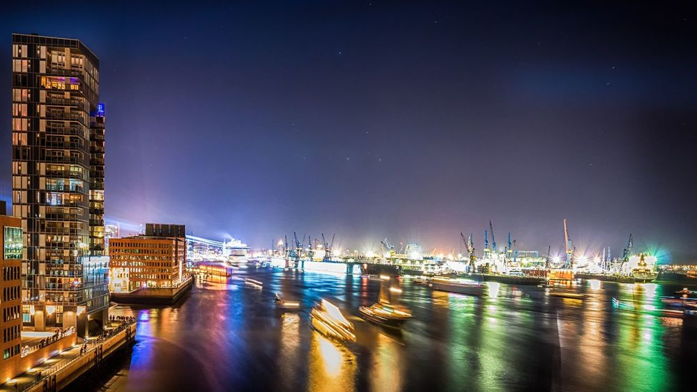 Hamburg Elbe Blue Port Hamburg Blue Port Illuminated Nautical Vessel Reflection Freight Transportation Transportation Harbor Building Exterior Industry Shipping  Sky City No People Outdoors Commercial Dock Architecture Water Built Structure Sea Fischmarkt Langzeitbelichtung Nachtaufnahme