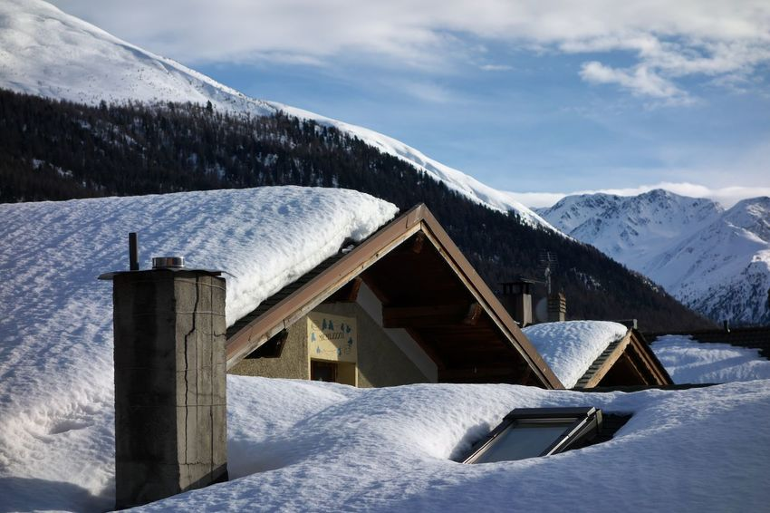 Snow Winter Cold Temperature Mountain Sky Architecture Scenics - Nature Built Structure Day Nature Mountain Range Cloud - Sky Beauty In Nature Tranquil Scene Building Exterior Building Tranquility No People Snowcapped Mountain Outdoors Ski Resort  Powder Snow