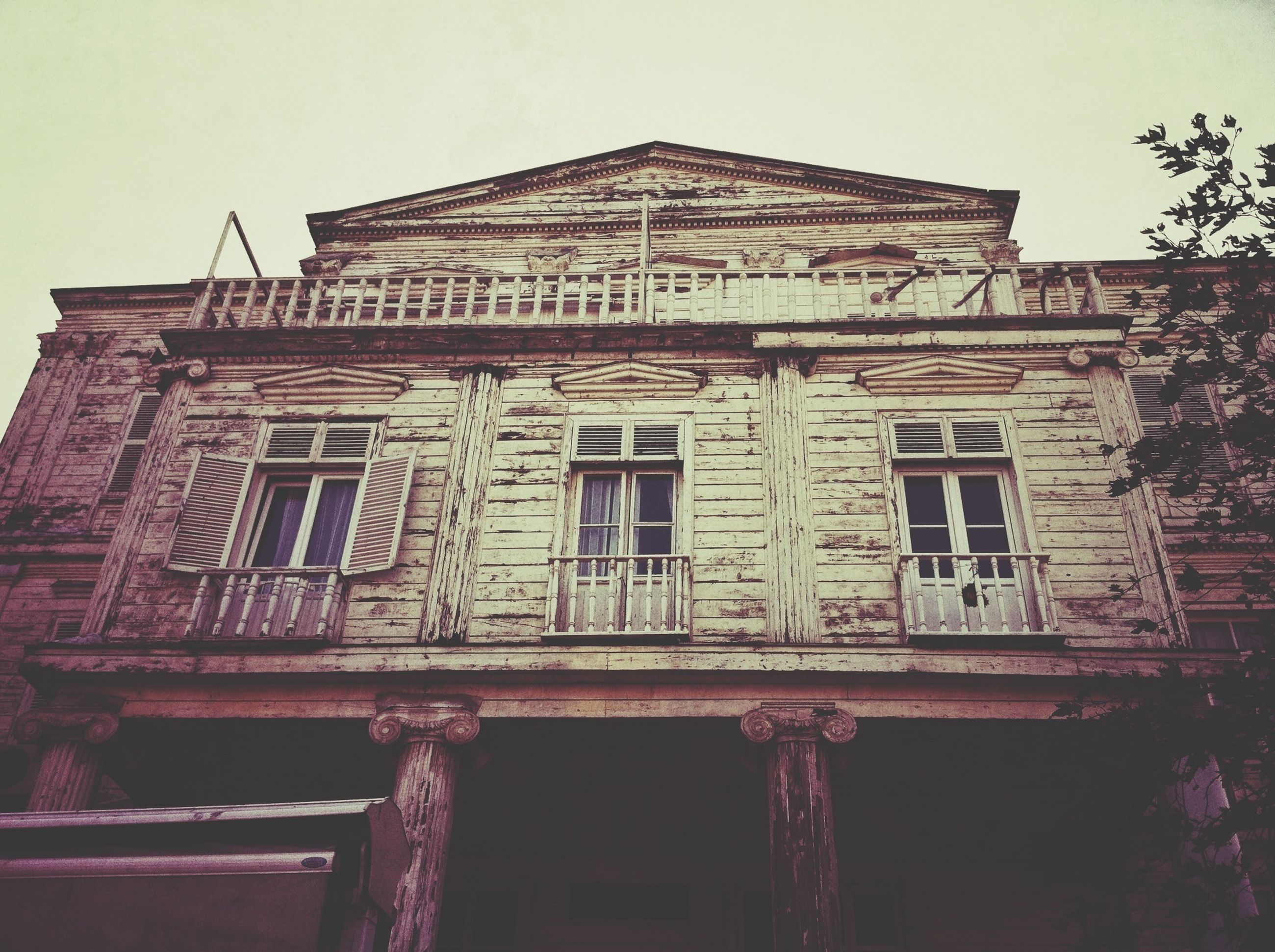 architecture, built structure, building exterior, low angle view, window, clear sky, old, building, facade, day, outdoors, no people, residential building, residential structure, sky, house, history, exterior, door, balcony