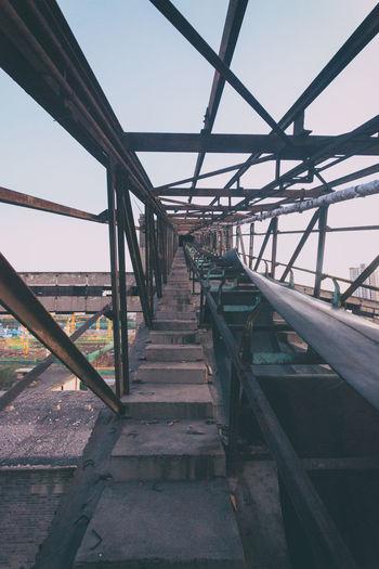 Metallic structure against sky