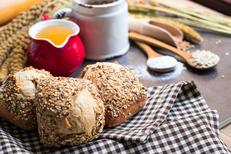 wholegrain bread and ingredients for bread preparation Bakery Baking Bread Cat Close-up Composition Food Food And Drink Grains Healthy Eating Indoors  JustMe Loa Loaf Nature Nature_collection Oil Spatula Spooky Still Life Table Wheat