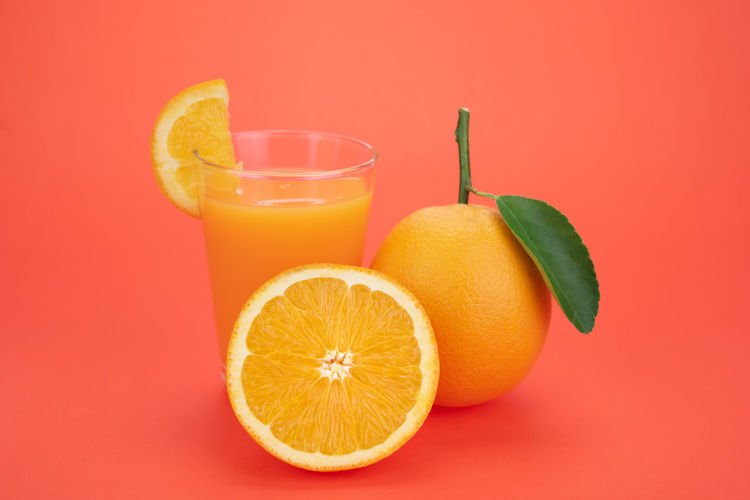 Food Fruit Food And Drink Healthy Eating Citrus Fruit Orange Color Wellbeing Freshness Orange - Fruit Orange Studio Shot Colored Background Glass Refreshment Drinking Straw Drinking Glass Indoors  Orange Juice  Drink Straw No People Ripe Vitamin C