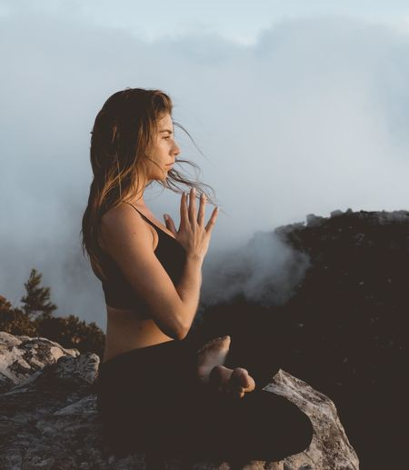 Yoga Meditation One Person Young Adult Real People Leisure Activity Holding Nature Young Women Lifestyles Day Outdoors Sky Full Length Women Landscape One Young Woman Only Adult People EyeEm Gallery Sunset Wellbeing Happiness Nature Tranquil Scene