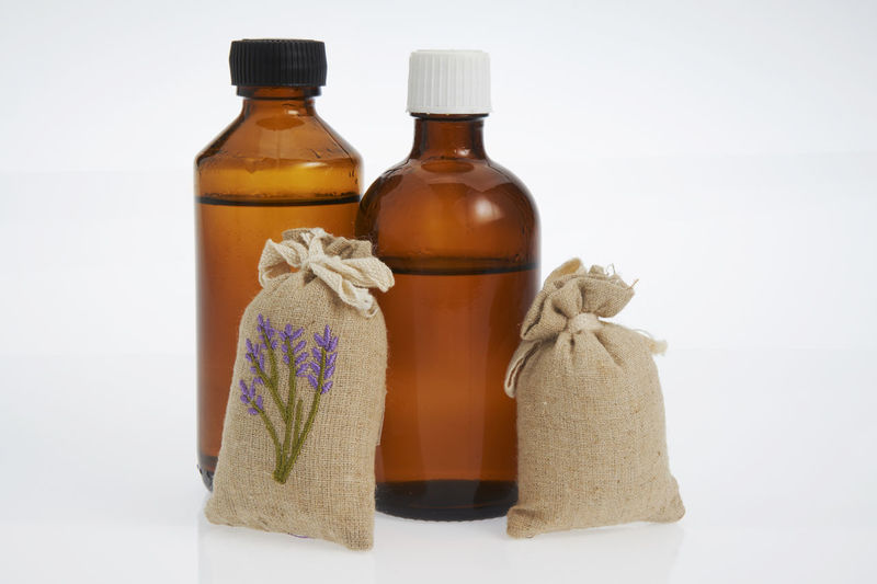 concept image of the aromatherapy Aromatherapy Alternative Medicine Aroma Bag Bottle Close-up Container Cut Out Essential Oils Fragrance Group Of Objects Healthcare And Medicine Healthy Lifestyle Indoors  Lavender Massage Oil Nature No People Sachet Scented Still Life Studio Shot Treat Wellbeing White Background