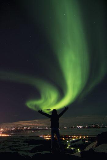 Silhouette Man Standing Against Aurora Polaris At Night