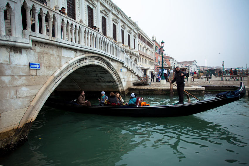 Venice, Italy. Gondolas, traditional old boats, sail across the city's canals and bridges. Boat Canal Canals And Waterways City Cityscape Gondola Gondolas Italy Oldcity Romantic Symbol Tourism Tourist Attraction  Traditional Transport Transportation Venezia Venice Venice, Italy Vessel Water Water_collection