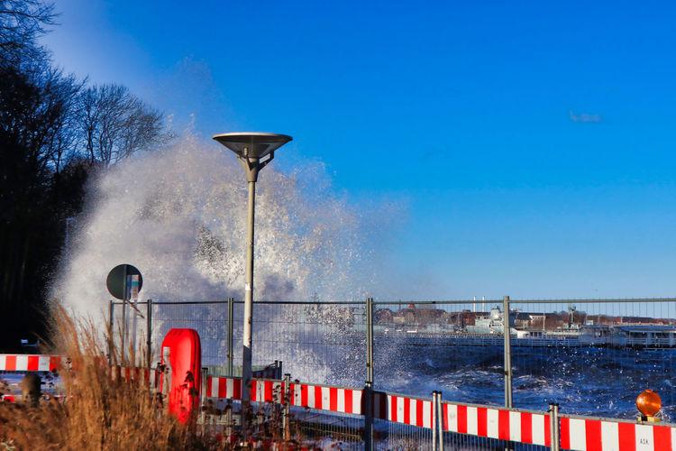 Sky Water Motion Barrier Sea Waterfront Wave Breaking Waves Spindrift Baltic Sea Blue Fence High Water Street Light Splashing