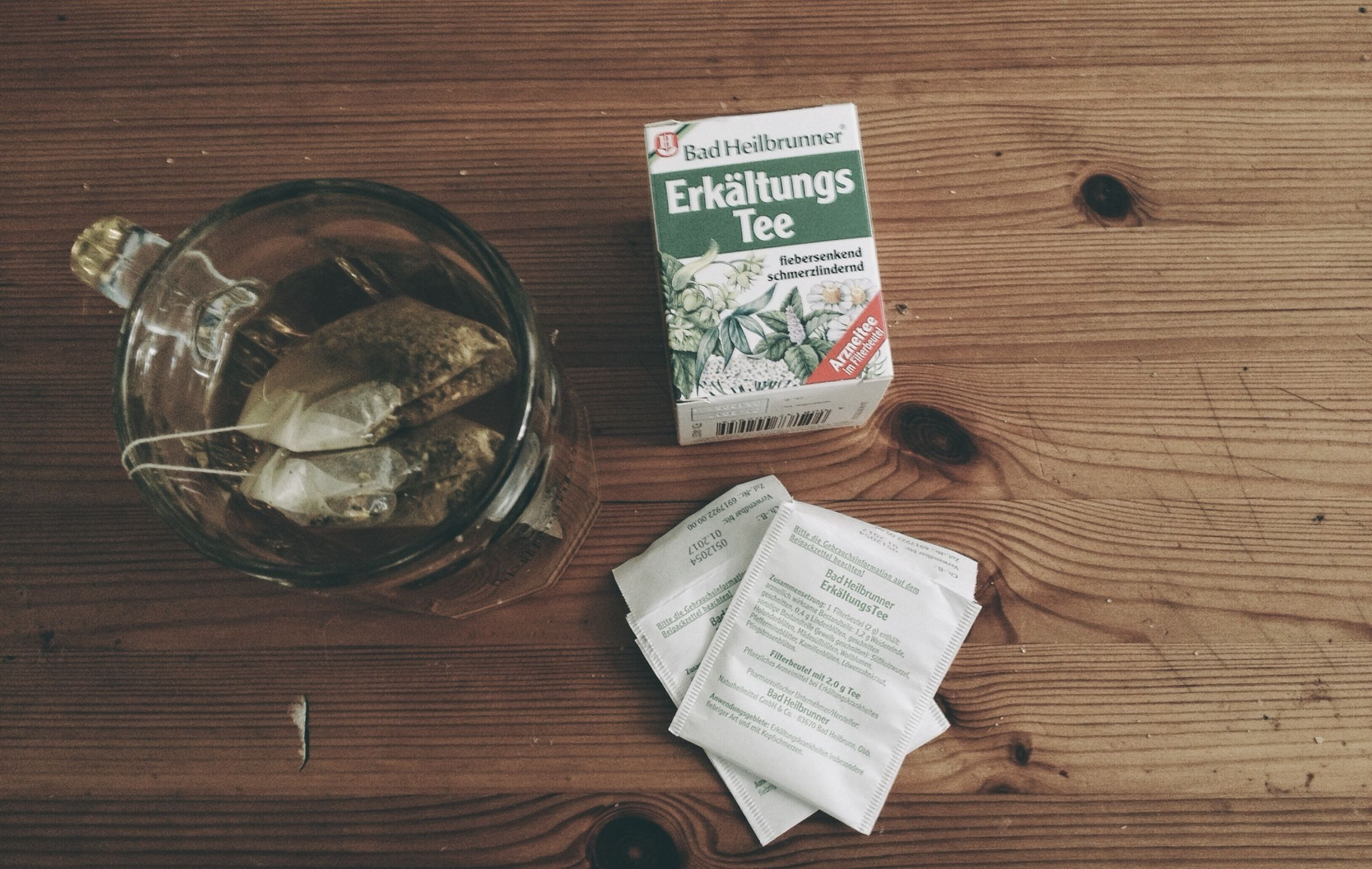 text, western script, food and drink, communication, indoors, still life, table, wood - material, freshness, high angle view, food, close-up, non-western script, paper, healthy eating, wooden, no people, information, book, refreshment