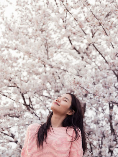 EyeEm Best Shots Spring Has Arrived Portrait Woman Tree Flower Young Women Springtime Branch Beauty Pink Color Head Back Women Beautiful Woman Cherry Blossom In Bloom