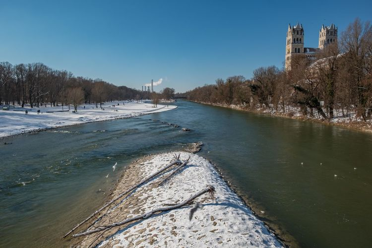 View of river in city during winter