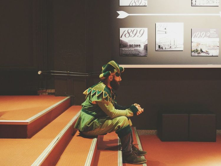 Waiting Male Actor Waiting Sitting On Steps Red Floor Costume Performing Beard Black Hair Be Someone Else Stage Hat Performing Arts Theater Showcase April EyeEm Best Shots Eye4photography  EyeEm Best Edits Pictures Hanging Stagefright Light And Shadow Telling Stories Differently