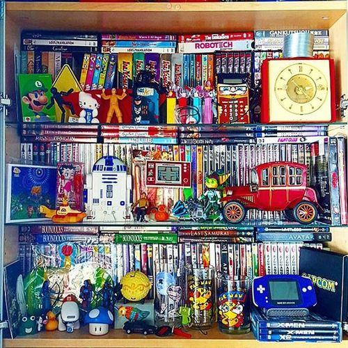Time for an unsolicited Shelfie ...trying to use every bit of space & it's all behind glass :) Includes: Gameandwatch Luigi , Anime , Dvds , Bluray , Siouxsie , Catwoman , Gameboy , R2D2 (Audiocassette players), Midcenturymodern items, video game pre-order exclusives (Katamari , Animalcrossing , Okami ), 80stoys like original Slinky  & LittleProfessor !, Pacman & ET glasses, Avatar (LastAirBender & those blue guys), BettyBoop , VivaPinata , Ratchetandclank , YellowSubmarine, etc. Nintendo, Atari, StarWarsfan, actionfigures, yay!