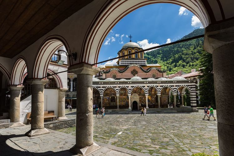 Rila Monastery Bulgaria Rila Mountain Travel Photography Monastery Religion Architecture Built Structure Arch Building Building Exterior Architectural Column Incidental People The Past Travel History Sky Tourism Religion Place Of Worship Sunlight Travel Destinations Belief