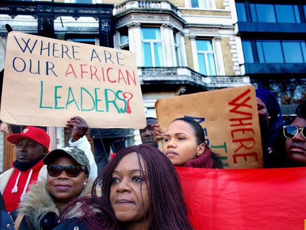 No Borders! No Slavery! Protest demanding an end to auctioning of black Africans in Libya. Following reports of people auctions in Libya. Libyan Embassy. London. UK. 26/11/2017 People Protestor Black Lives Matter Zuiko Libya London Slavery Protest Slavery Still Exists Protesters Photojournalism Olympus Stevesevilempire People Auctions Steve Merrick No Borders! No Slavery! London News