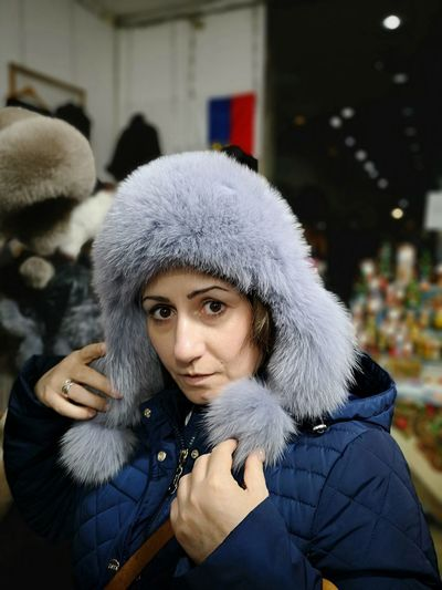 Winter Portrait Warm Clothing Real People One Person Clothing Looking At Camera Leisure Activity Fur Front View Lifestyles Young Adult Cold Temperature Women Fur Coat Focus On Foreground Young Women Headshot Fur Hat Beautiful Woman Hood - Clothing
