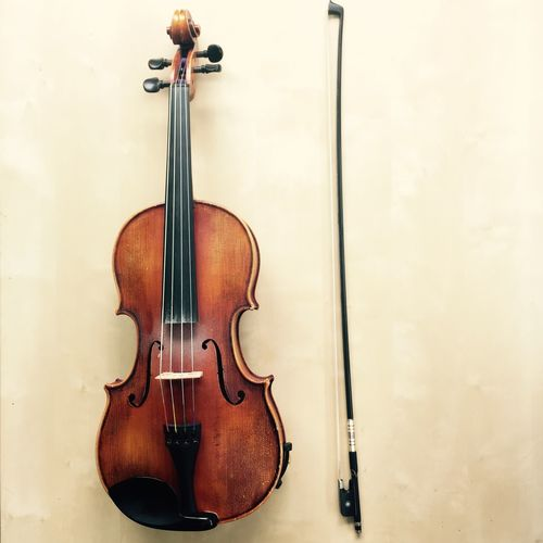 High angle view of violin and bow on table