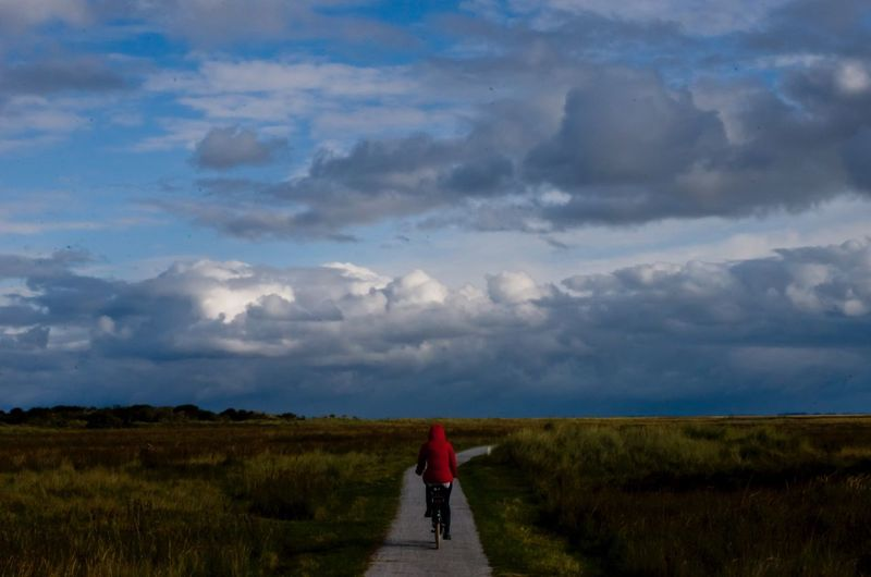 Cycling girl Cloud - Sky Field Landscape One Person Nature Outdoors Leisure Activity Grass Cycling Schiermonnikoog