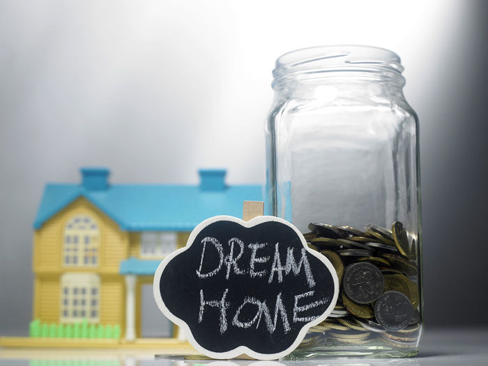 Coins in jar with dream home label