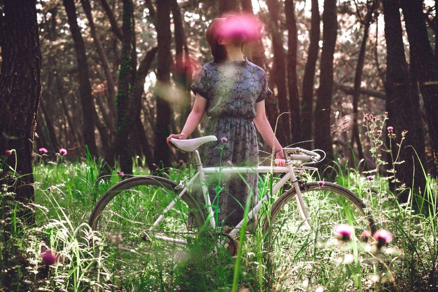The Portraitist - 2017 EyeEm Awards The Great Outdoors - 2017 EyeEm Awards Flower Outdoors One Person Bicycle Forest Growth Portrait EyeEmNewHere Field Beautiful Woman Colors Mid Adult Lifestyles EyeEm Best Shots Women