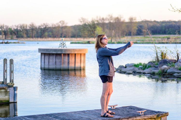 Full length of woman standing in lake