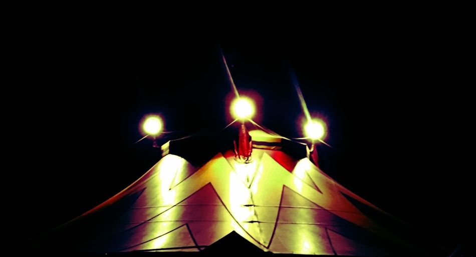 Art Black Background Circuas Close-up Dark Decoration Design Electric Lamp Electric Light Glowing Illuminated Light Lighting Equipment Lit Low Angle View Multi Colored Night No People Outdoors Sky Yellow The Magic Mission Check This Out Circus Medieval