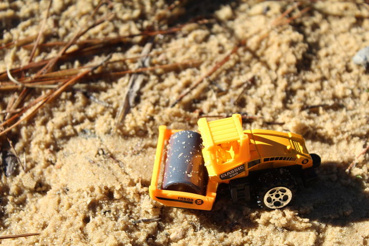 Close-up of toy car on sand
