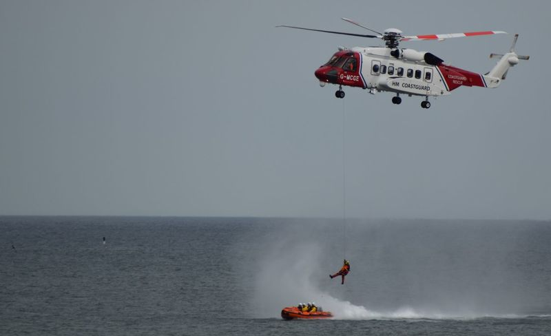 RNLI Open Day, August 2017. Withernsea lifeboat, Humber Lifeboat, RNLI Coastguard Rescue Helicopter Lifeboat RNLI Adult Adventure Boat Coastguard Day Extreme Sports Flying Helicopter Horizon Over Water Lifeboat RNLI Mid-air Nature One Person Outdoors Parachute People Rescue Sea Skill  Sky Water Winchman