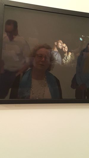 A human figure reflected in another human picture. At Haifa Museum