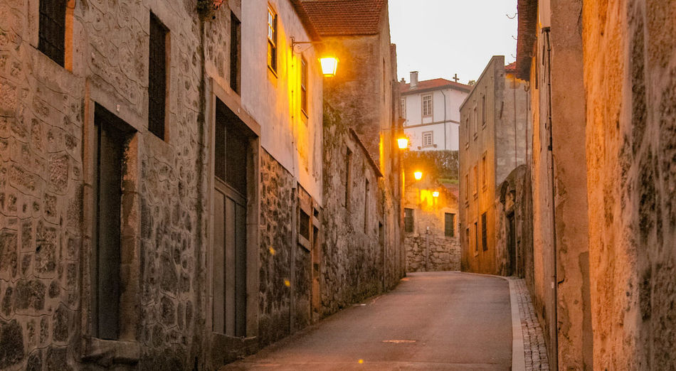 Architecture City Building Exterior Sunset Street City Street Outdoors Yellow No People City Life Built Structure Illuminated Portugal Vila Nova De Gaia Old Buildings Old Street Classic Street Wine Cellar History