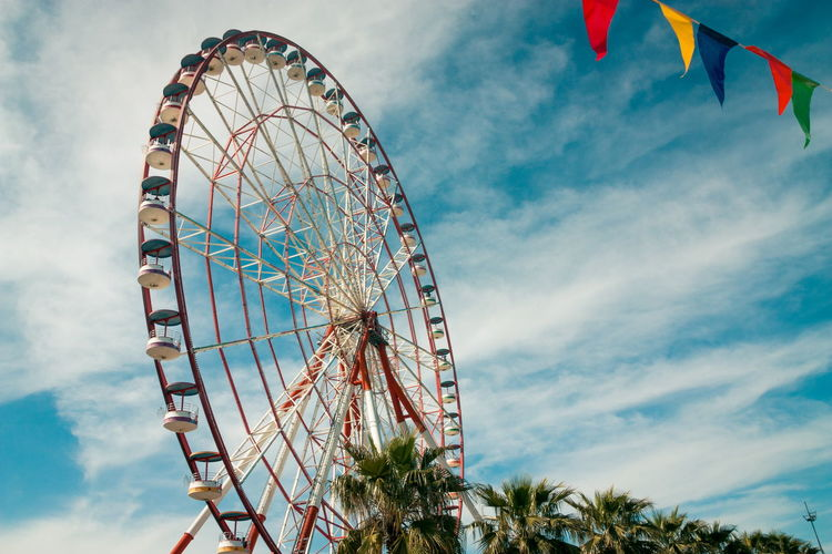 Amusement Park Amusement Park Ride Arts Culture And Entertainment Carnival Celebration Cloud - Sky Day Ferris Wheel Festival Flag Fun Leisure Activity Low Angle View Multi Colored Nature No People Outdoors Shape Sky Traveling Carnival Tree