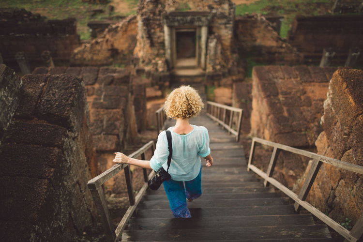 Cambodia Siem Reap Angkor Architecture Boys Built Structure Casual Clothing Child Childhood Curly Hair Day Deterioration Full Length Girl Hair Hairstyle History Innocence Leisure Activity Males  Men One Person Outdoors Ruined Staircase Standing The Past A New Beginning