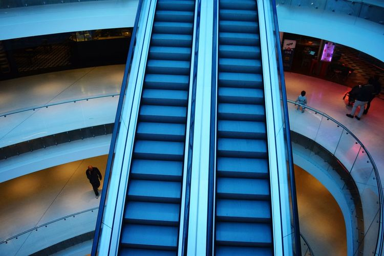 High Angle View Of Escalators In Shopping Mall