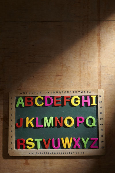 alphabet a to z on the blackboard Alphabet Education Blackboard  Chalkboard Directly Above A To Z English Colorful Text Western Script Table Indoors  Communication Wood - Material Multi Colored Capital Letter No People Message Toy Block Toy Hardwood Floor Flooring Letter Wood Grain Close-up