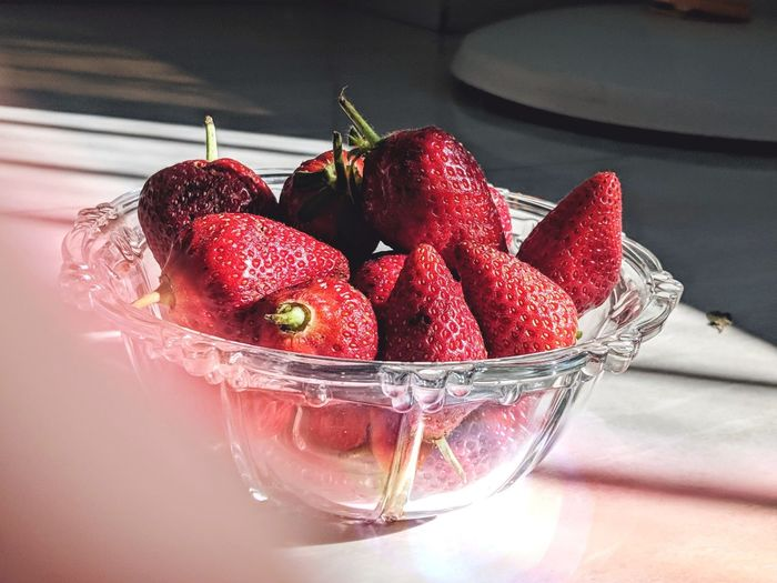Close-up of strawberries in glass bowl on table