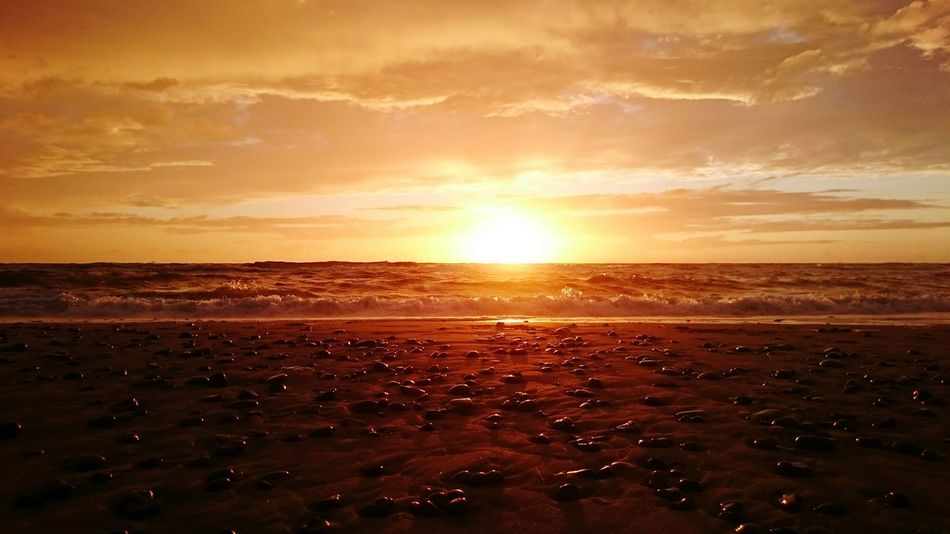 Sunset Sea Sun Beach Dramatic Sky Orange Color Scenics Tourism Nature Beauty In Nature Vacations Tranquility Outdoors Sky Landscape Sunlight Reflection Travel Travel Destinations
