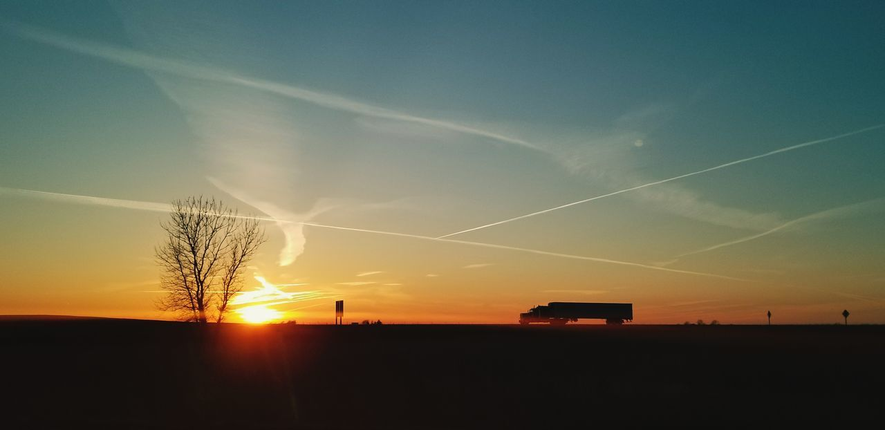 Sunsets and silhouettes Sunet Sun Silhouette Truck BareTrees Colourful Nature Trees Sunset Silhouette Sky Vapor Trail Farmland