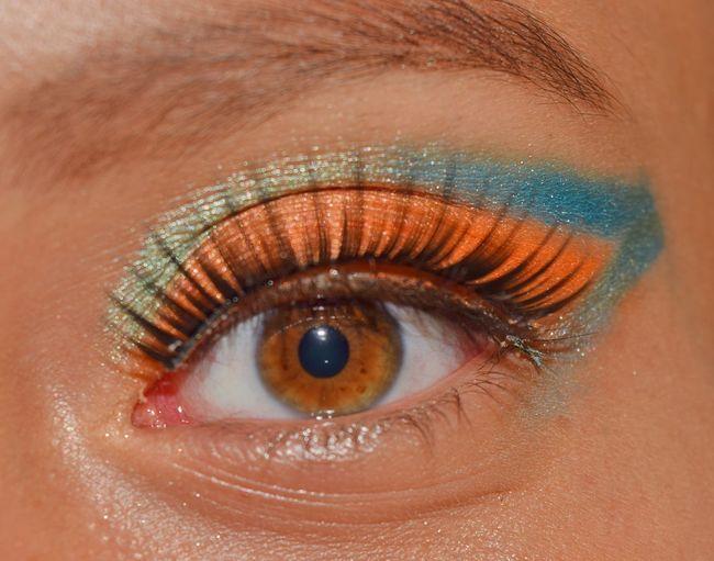 Cropped image of woman eye with eyeshadow