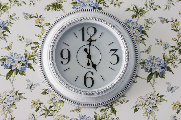Low angle view of clock on plants