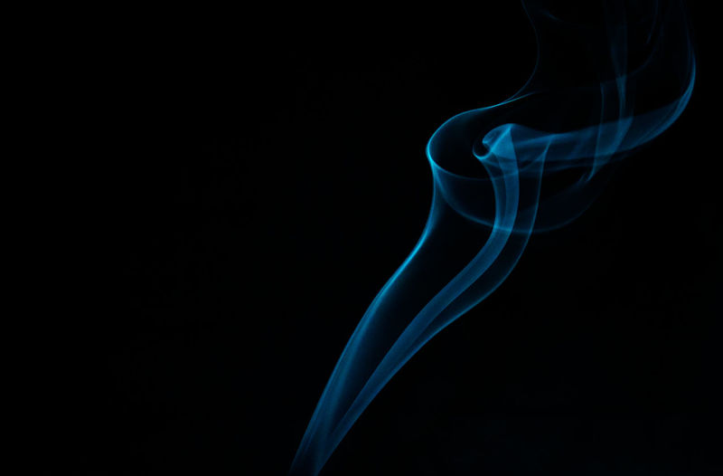 Close-up of smoke against blue background
